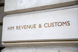 HM Revenue and; Customs sign incised into the wall outside their headquarters in Whitehall, City of Westminster, London